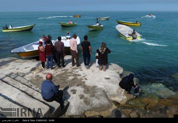 تصاویر/ مسافران نوروزی در ساحل بوشهر